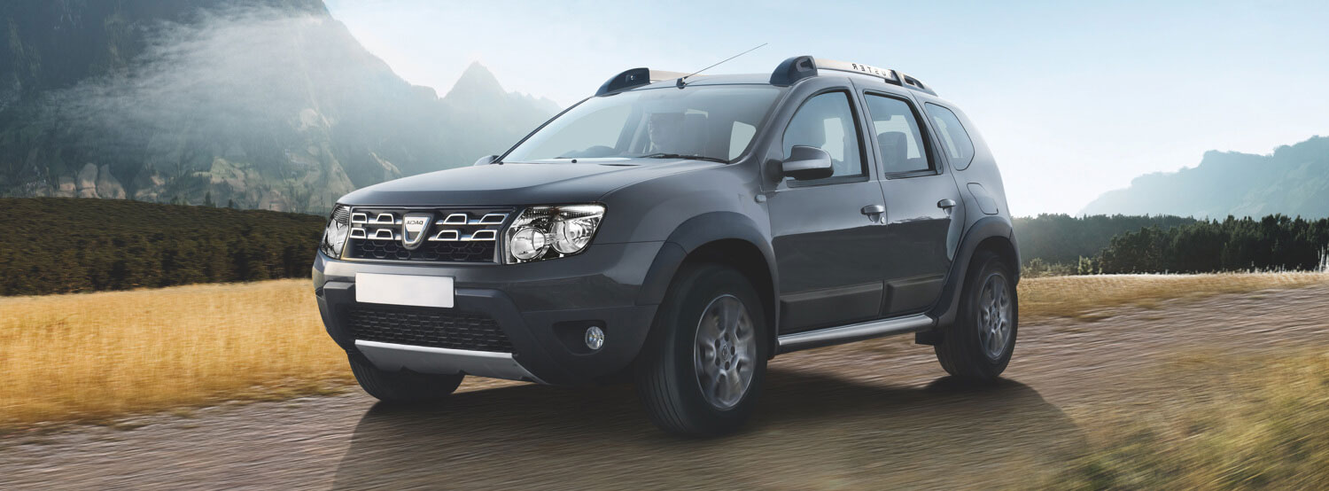 Dacia Duster driving on a country road.