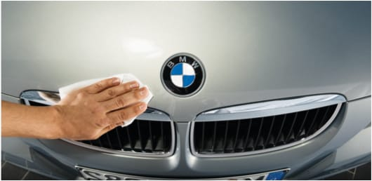 BMW technician polishing car bonnet