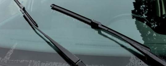Car wiper blades resting on a windshield