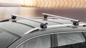 Silver Skoda Octavia equipped with a roof box