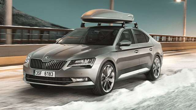 Silver SKoda Superb with roof rails and box