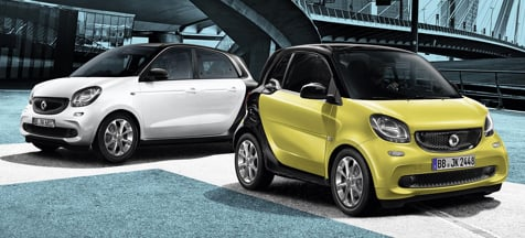 smart forfour and smart fortwo parked together