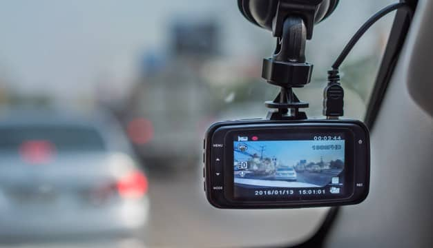 A dash cam recording the road ahead.