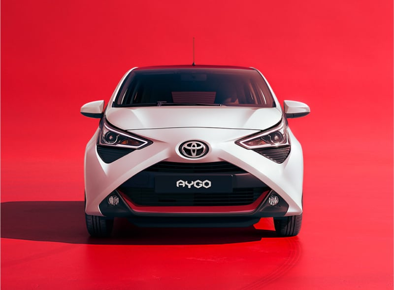 White Aygo on a red background