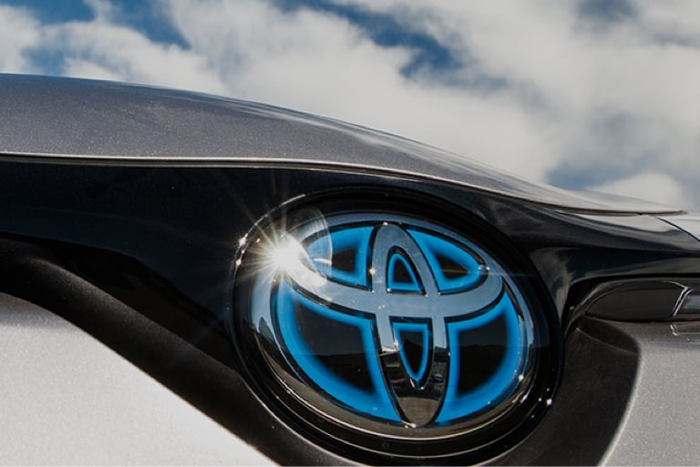 Close-up of a Toyota Hybrid badge.