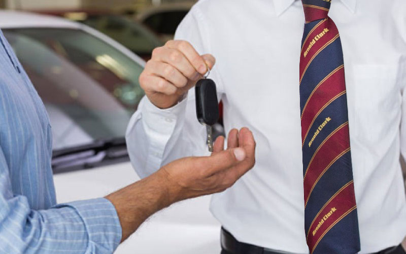 Car keys being handed over to a customer