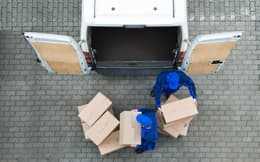 Image of men loading a van