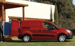 Image of a small red van being loaded