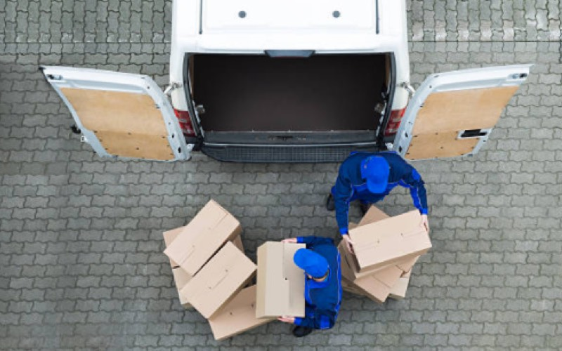 Men packing boxes into a van