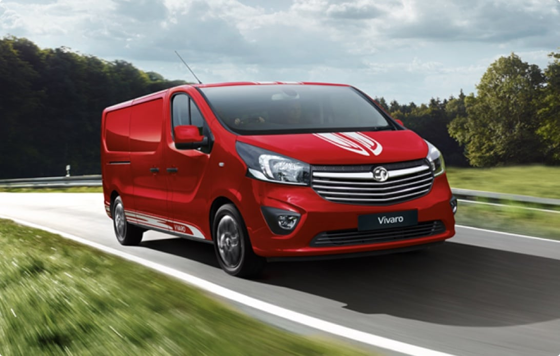 Red Vivaro van on a country road