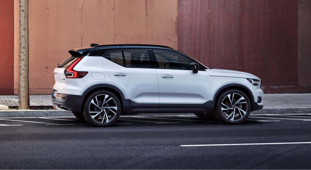 Side view of white Volvo XC40 on street