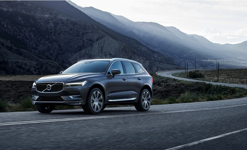 XC60 driving past mountains.