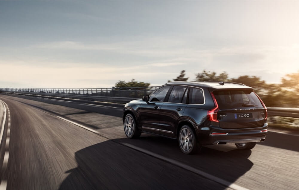 Black Volvo XC90 driving on motorway